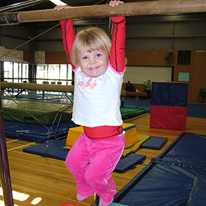 Hanging on bars at Fun Gym